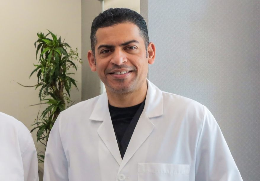 Dr. Hassan smiling