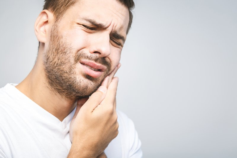 Man needing to see an emergency dentist in Coral Springs